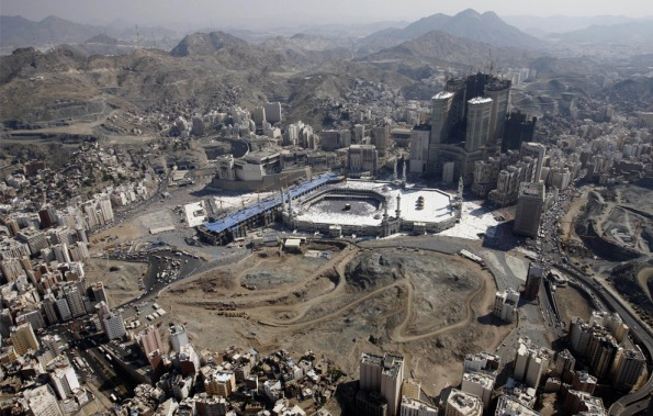 Tens of thousands of Muslim pilgrims move around the Kaaba, the black cube seen at center, inside the Grand Mosque, during the annual Hajj in Mecca, Saudi Arabia, Tuesday, Dec. 9, 2008. (AP Photo/Hassan Ammar)