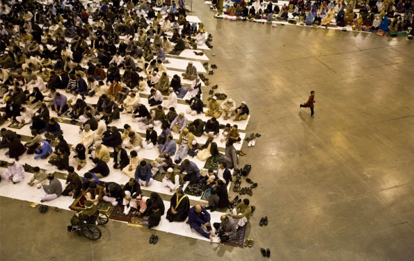 Some of the approximately 12,000-13,000 members from 19 mosques in the Islamic Society of Greater Houston gather on Moday, Dec. 8, 2008 to celebrate Eid-al Adha at the Reliant Center Hall in Houston, Texas. (AP Photo/ Michael Paulsen / Chronicle )
